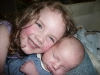 Sisterly cuddles.