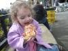 CareBear enjoys Fair pizza.