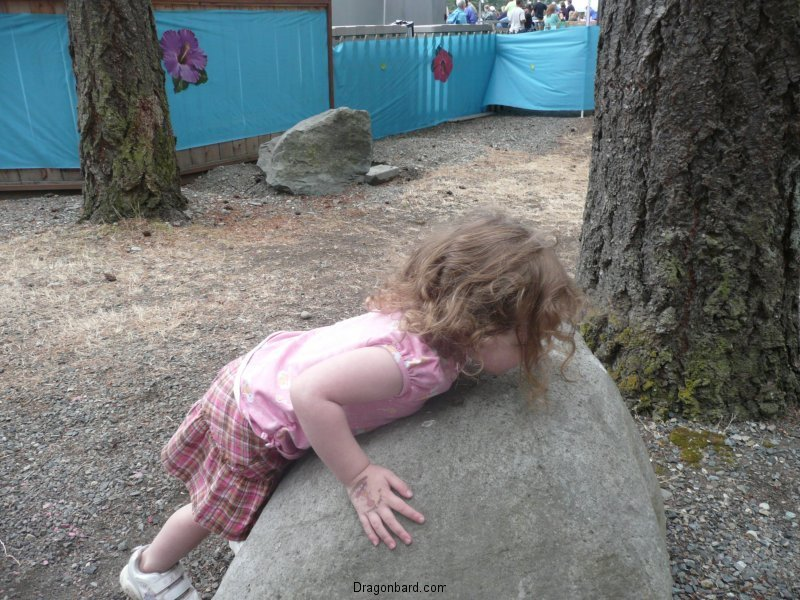 So she tries to lift the rock.