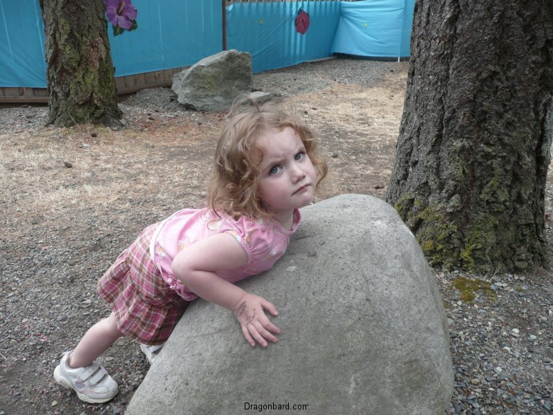 But she cannot lift the rock.