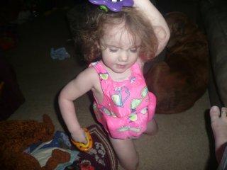 CareBear dances with the bath toys.