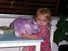 LiliBee loves her piggy bank.
