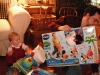 Papa helps open presents.