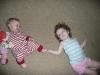 CareBear and LiliBee roll on the floor.