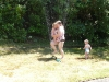 Teaching the kids to jump through the sprinkler.