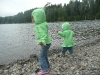 CareBear and LiliBee throw things in the lake.