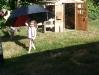 Under her umbrella.