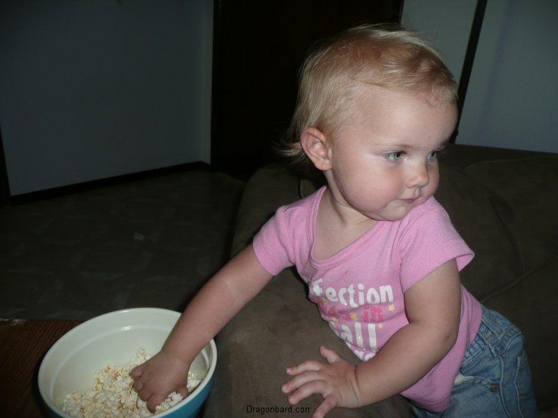 """LiliBee \""""borrows\"""" some of CareBear\'s popcorn."""
