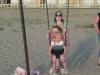 Two kids, one swing.