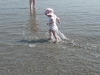 LiliBee chases the waves.