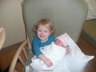 LiliBee likes holding the new baby.