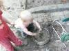 Stirring mud.