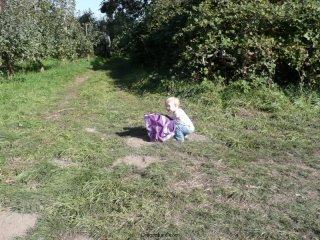LiliBee checks the apple haul.