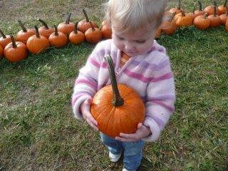 LiliBee is proud of her pumpkin.