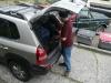 Chris unpacks the car.