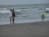 Auntie T, Grandma and Hannah on the beach.