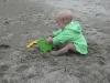 LiliBee makes a sand castle.