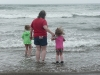 Cousin H, Amy and CareBear contemplate the waves.