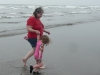 CareBear and Amy head out of the ocean.
