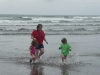 The waves are chasing CareBear, Amy and Cousin H!