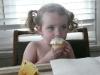 CareBear enjoys a cupcake.