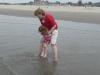 Auntie T saves CareBear from a giant wave.