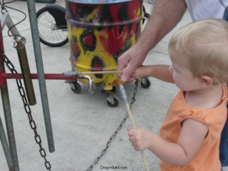 LiliBee bangs a drum.